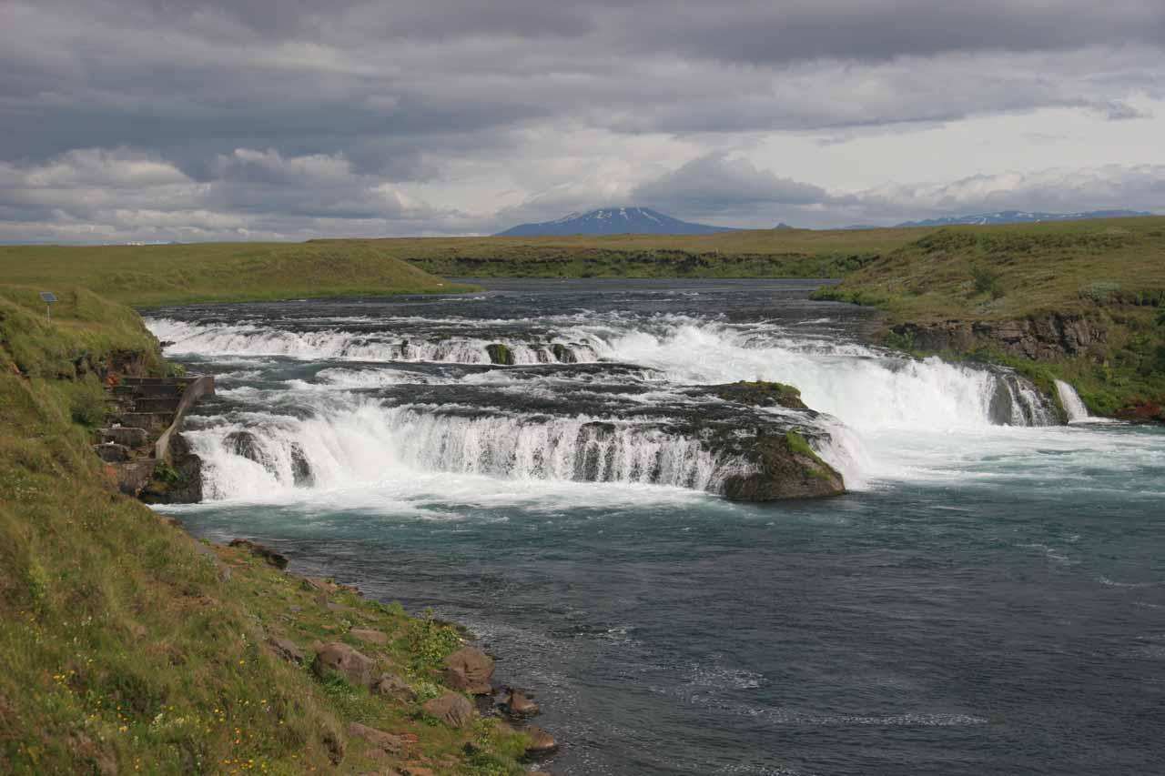 Full context of Ægissufoss with Mt Hekla in the background. I think it's that volcano in the background that really is this waterfall's draw card
