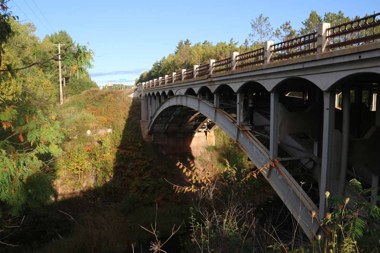 Examining the arched bridge over the Middle Branch of the Ontonagon River from the Agate Falls Trail