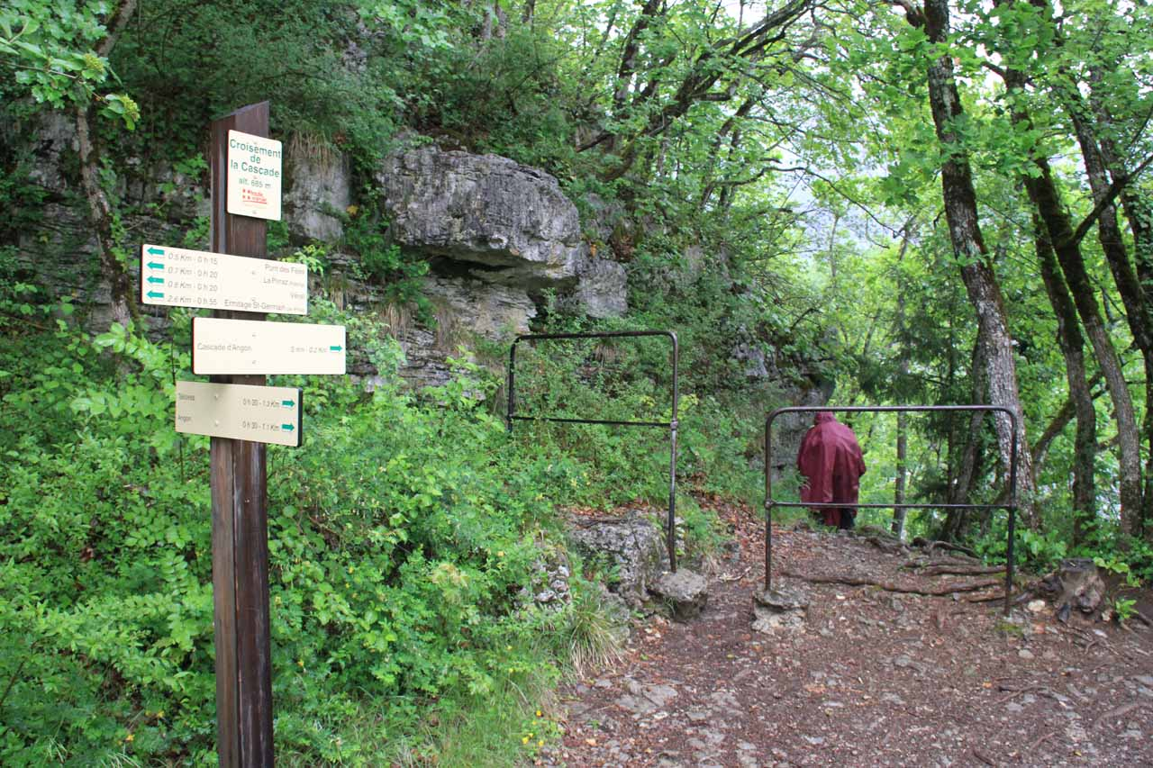 Signs at a trail junction where the trail was about to get to a cliff-hugging section