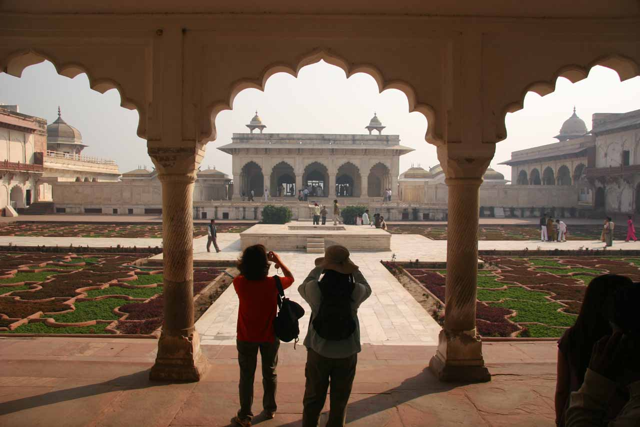Julie and some other person taking a photo of a large courtyard of the Agra Fort