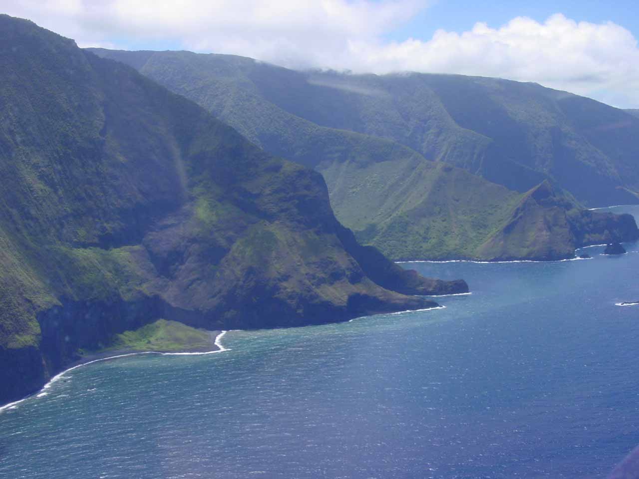 The sea cliffs of Molokai with glare through the side window clearly visible on the water
