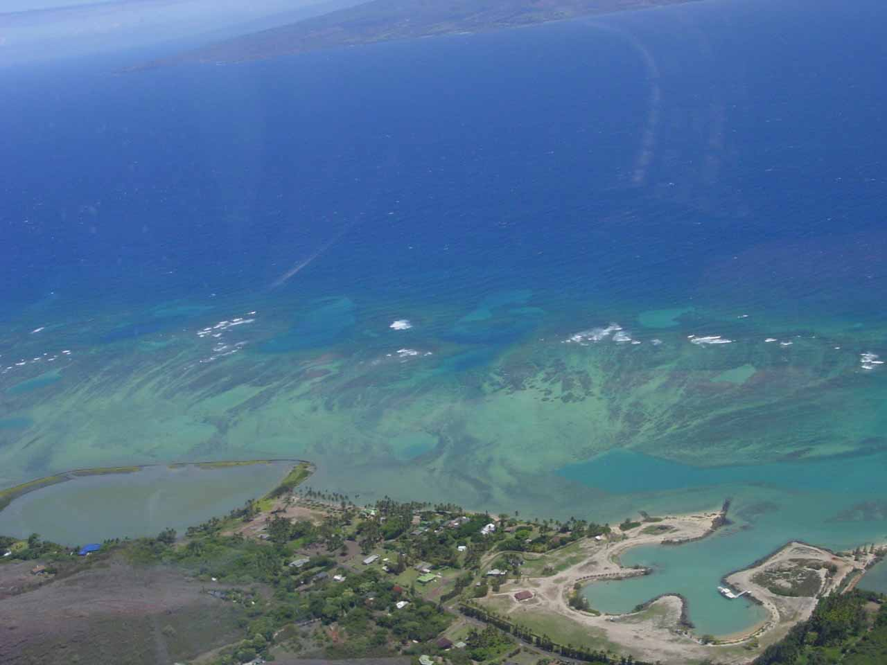 Looking down at reefs and fish ponds as we left Molokai on our September 2003 tour