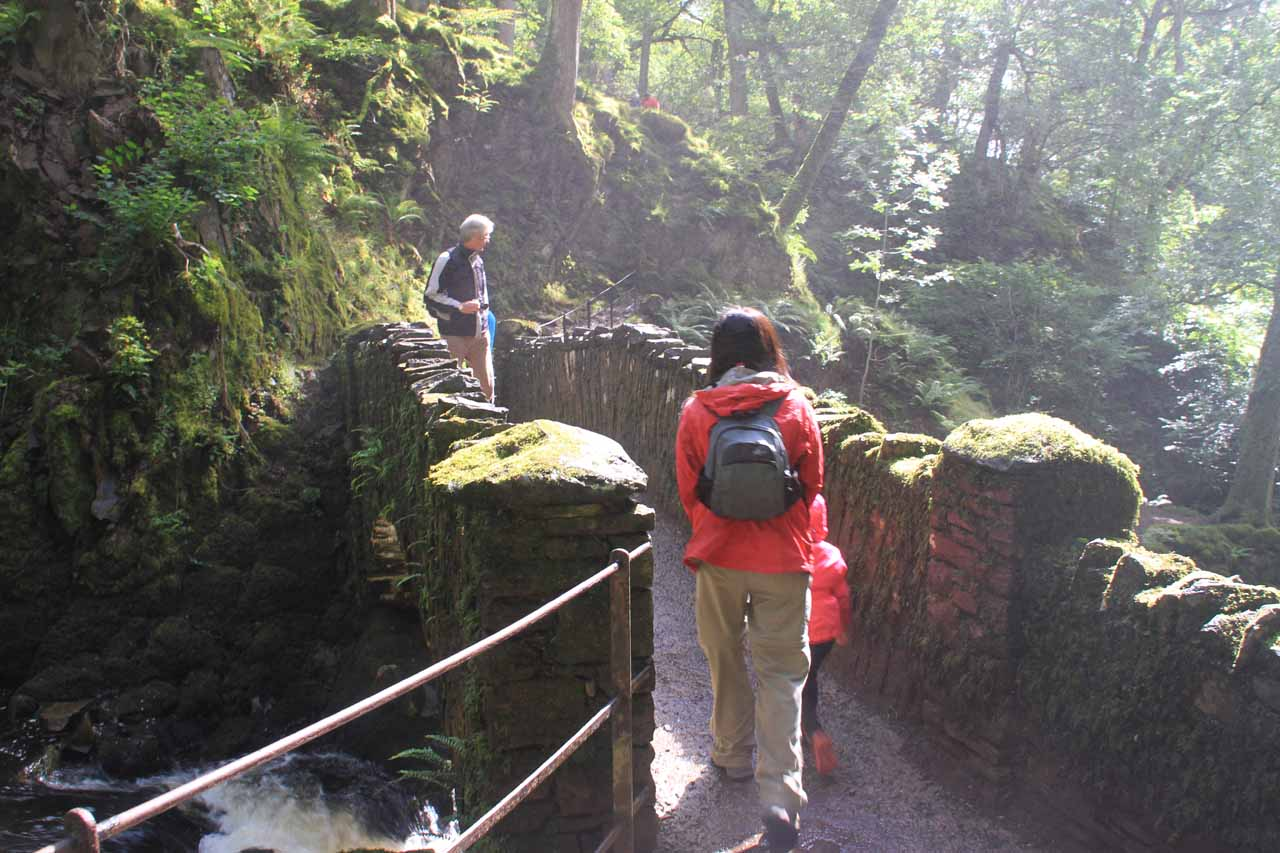 Julie and Tahia getting past the mist at the base of Aira Force
