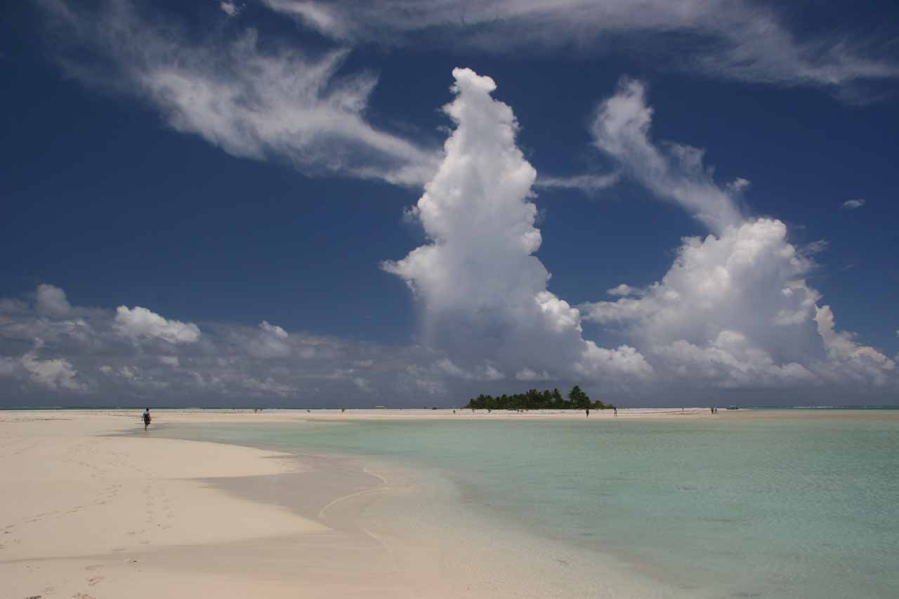 Wet Season thunderclouds rising high above the sandbars of one of the islands of Aitutaki