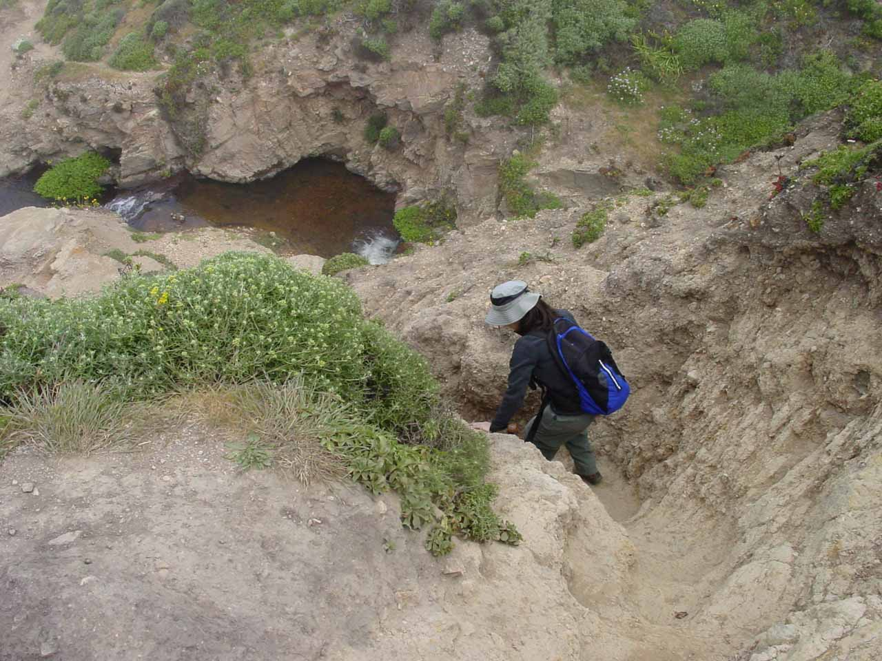 Julie continuing the descent with Alamere Creek below
