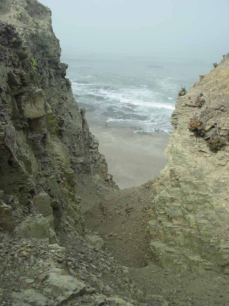 Looking down at the steep scramble to get down to the beach