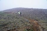 Aldeyjarfoss_045_08122021 - Mom continuing to climb back up towards the car park for Aldeyjarfoss under the thickening fog