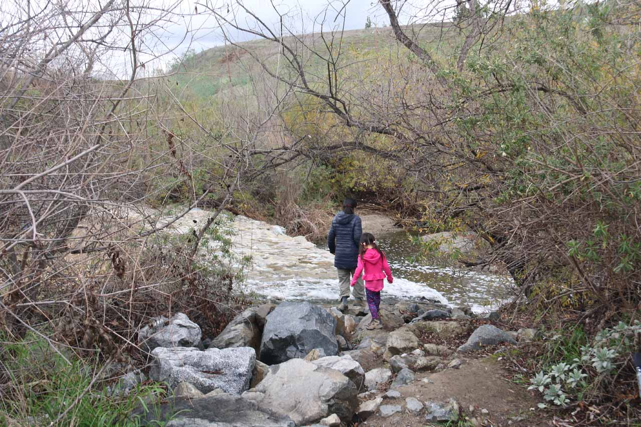 Julie and Tahia checking out the brink of the Aliso Viejo Waterfall