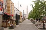 Alta_003_07052019 - Looking towards the far end of a pedestrianized street with the Northern Lights Cathedral of Alta in the background