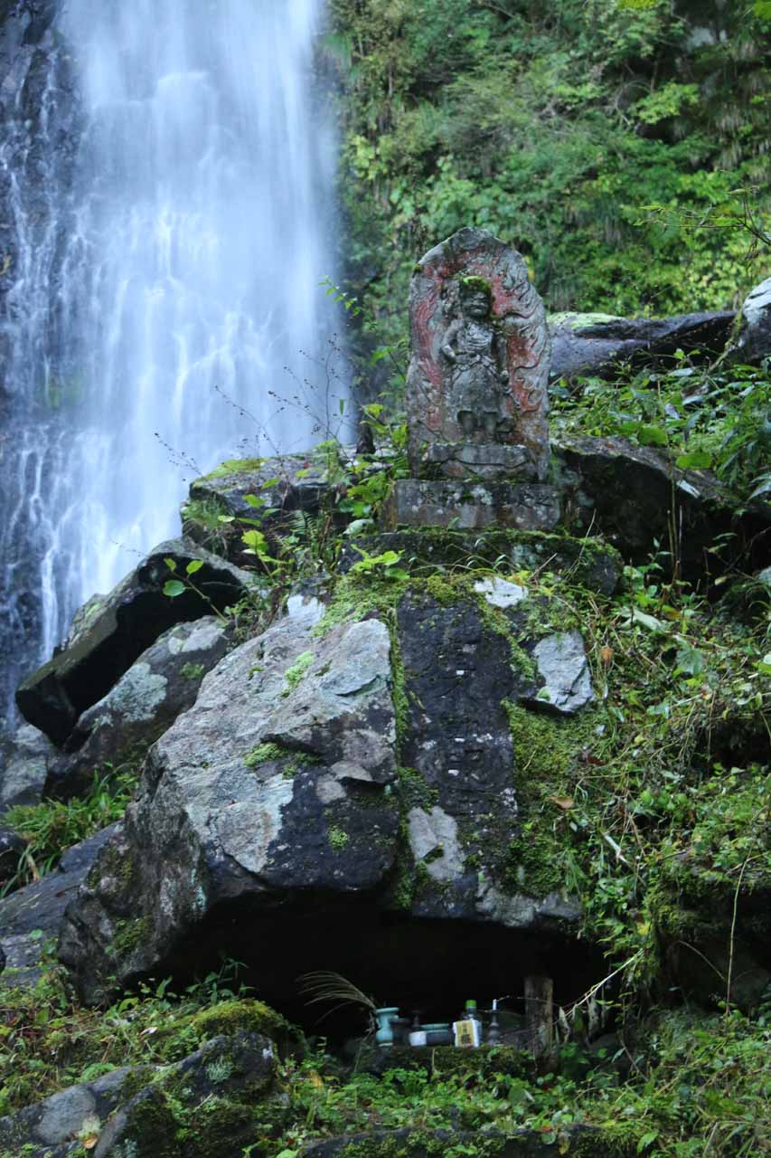 Near the base of the Amedaki Waterfall, we noticed this figurine as well as some offerings beneath a rock