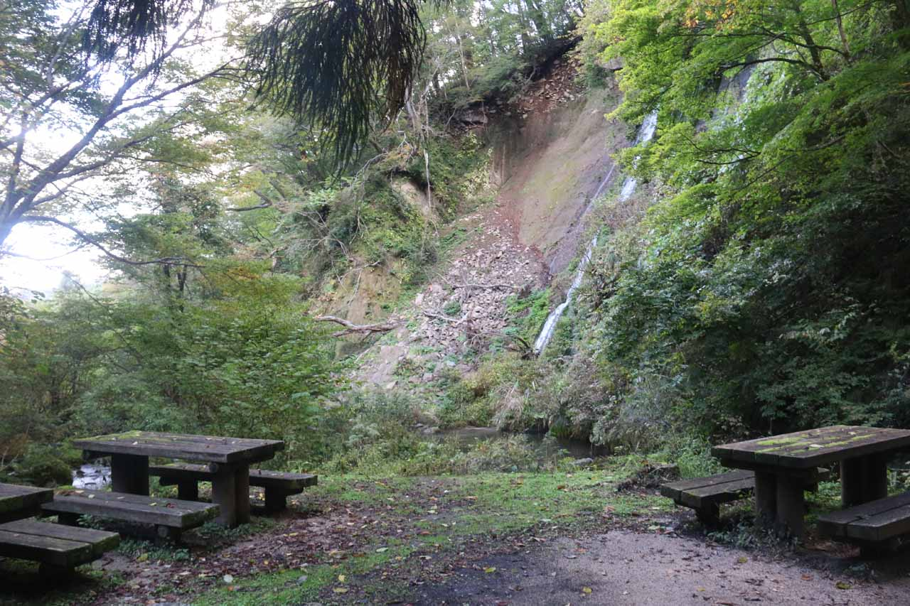 Picnic tables fronting the base of Nunobiki Falls