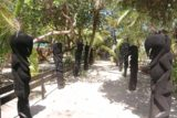 Amedee_341_11302015 - A line of black-stoned statues leading to the dining area of Mary D on Amedee Island