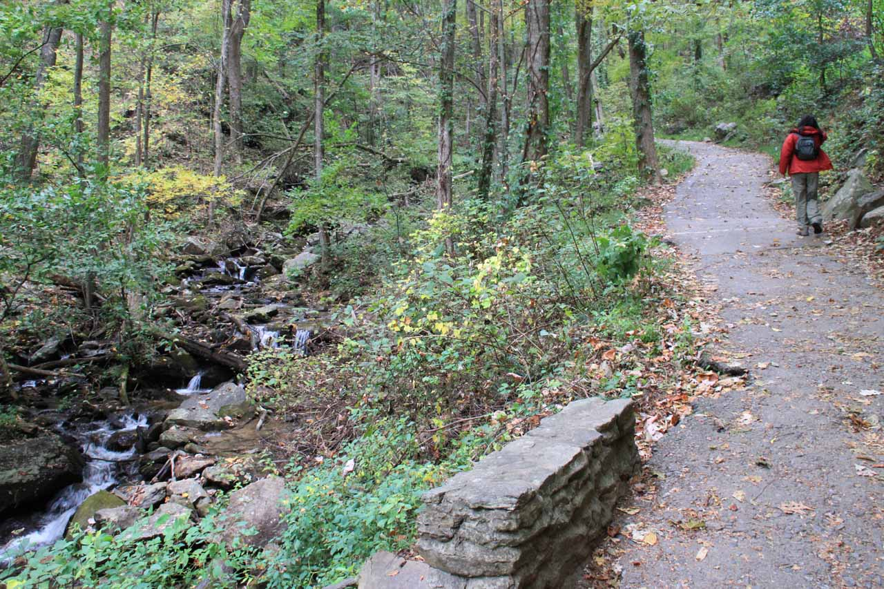 The paved strail alongside the stream