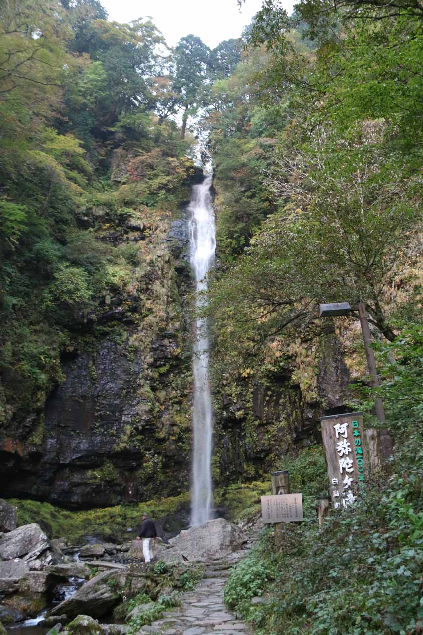 Signage fronting the tall Amida Waterfall