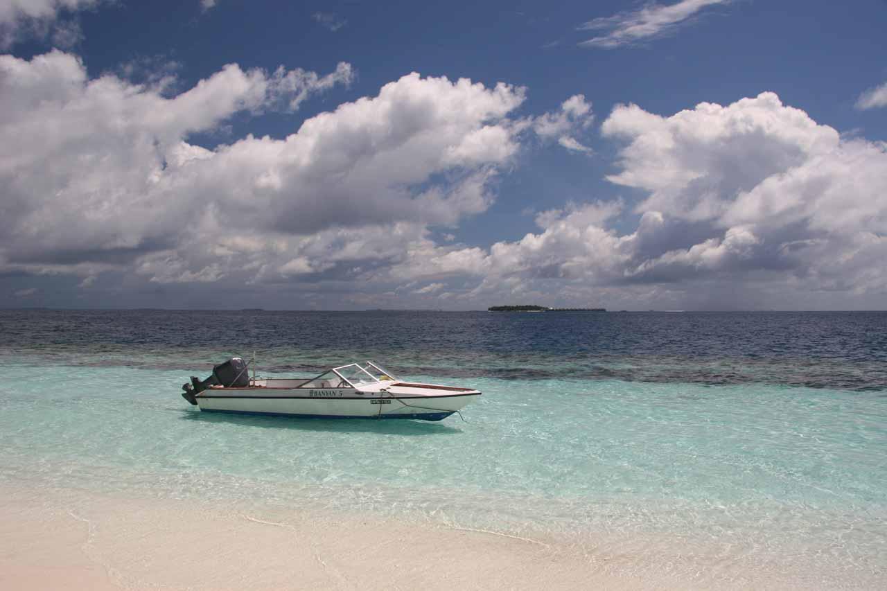 Looking past a boat docked at the Angsana Resort