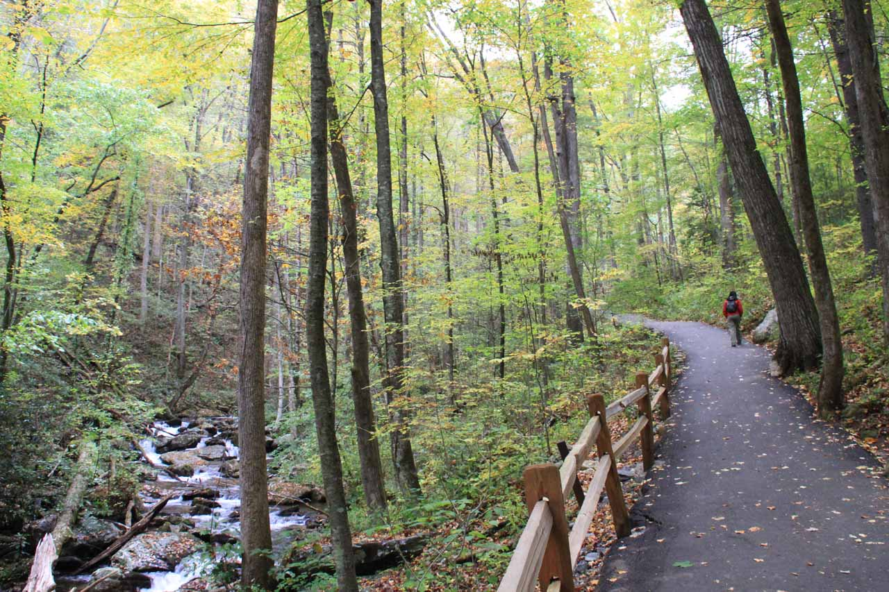 The paved trail follows the stream