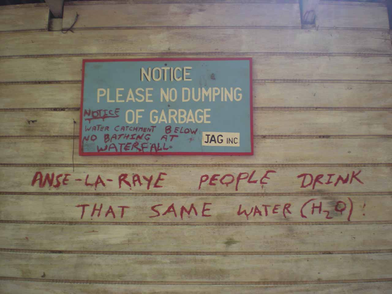 Some writing on the shack at the trailhead for Anse La Raye Falls