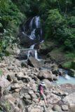 Anse_La_Raye_Falls_036_11282008 - Julie crossing before the Anse La Raye Falls as she heads back to the trailhead