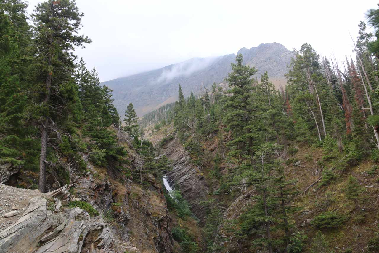 Contextual first glimpse at the Appistoki Falls nestled in a steep gorge