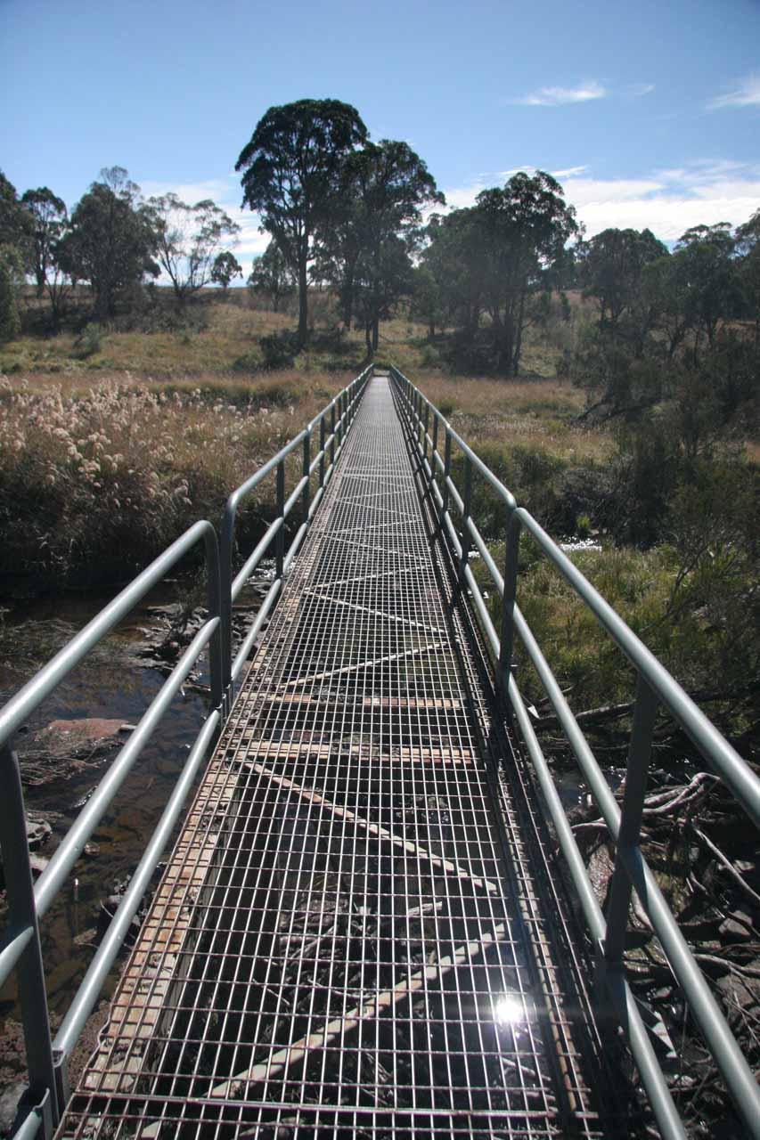 Crossing the metal bridge traversing the Apsley River