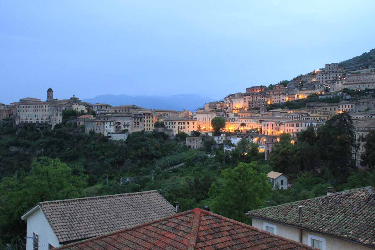 Broad contextual twilight view of Arpino under the rain