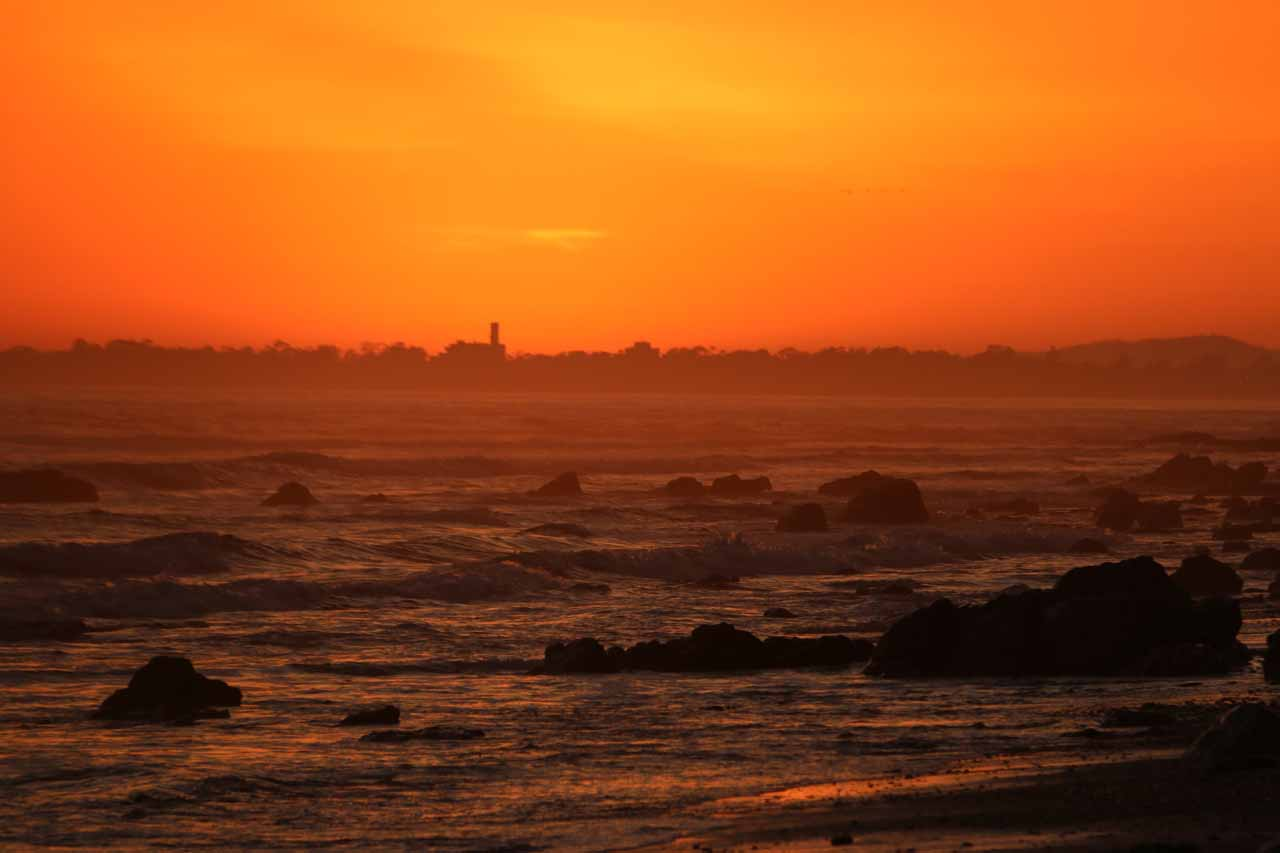 The sun sunk behind what appeared to be some coastal town way in the distance that could very well be San Luis Obispo