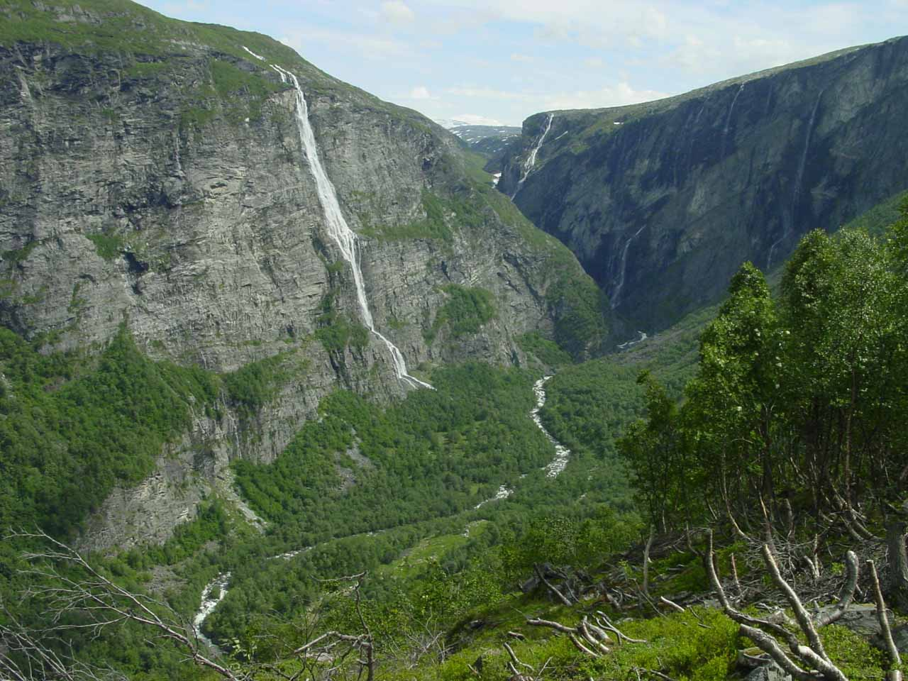 This giant waterfall was one of a series of them seen from the Aursjøvegen Road at the head of Eikesdalen.  I believe it's on the brook Slættabekken so it could be called Slættabekkfossen