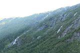 Aursjovegen_021_07162019 - Looking towards the west wall of Eikesdalen at Tverrgrovafossen and Hovlafossen near the head of Eikesdalen en route to the Aursjovegen