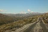 Aursjovegen_102_07162019 - Driving on the plateau along the Aursjovegen with still a few more cascades coming down the head of Eikesdalen in the distance below