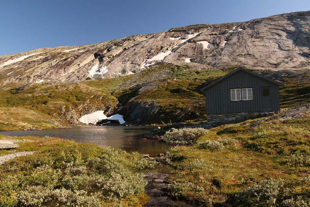 Aursjovegen_121_07162019 - Looking towards a cabin and alpine tarn on the mountain plateau between Eikesdalen and Litldalen along the Aursjøvegen