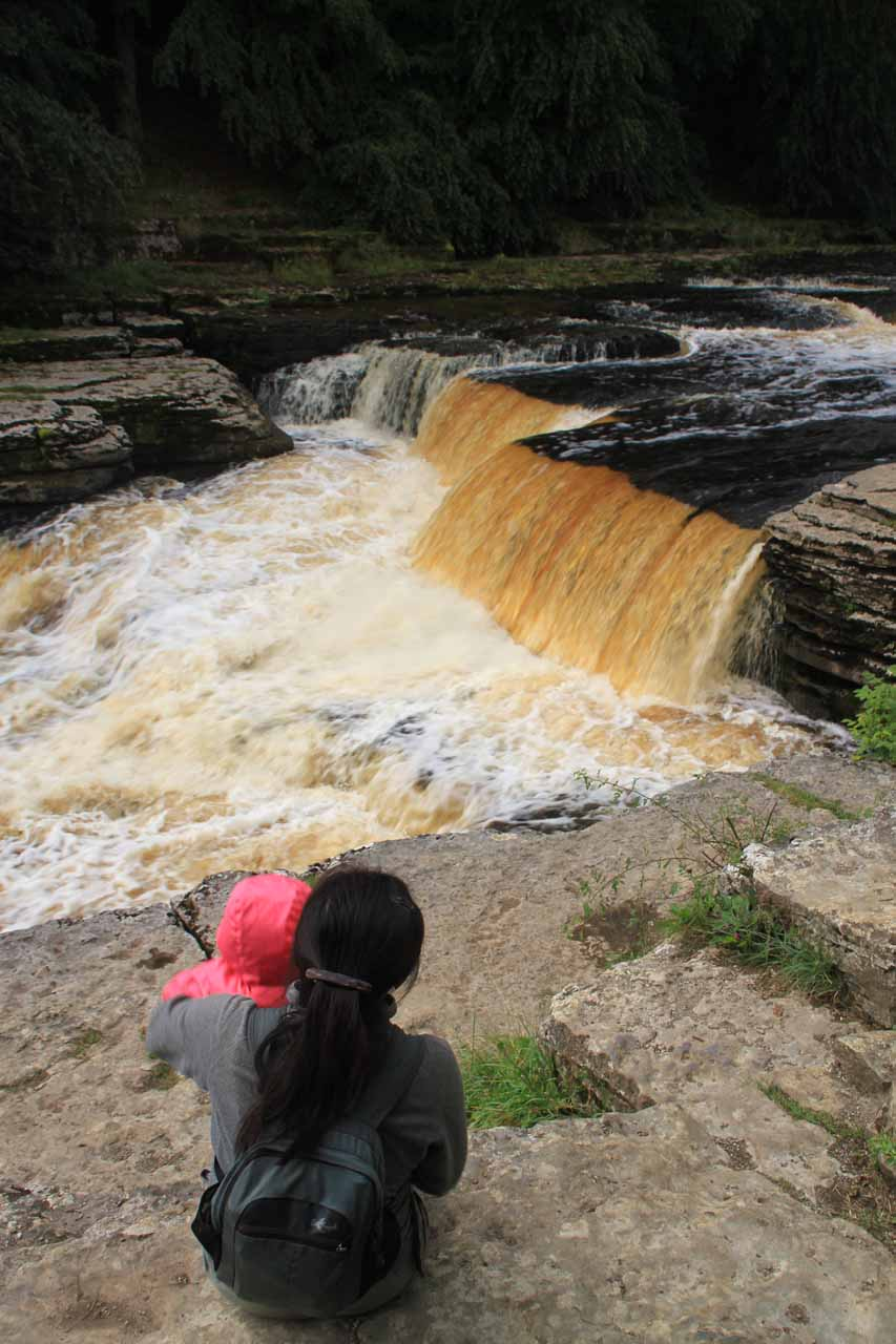 Julie hanging onto Tahia at Lower Aysgarth Falls, especially since there are no railings or preventative features to keep her from getting dangerously close to the edge
