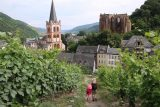 Bacharach_481_06172018 - Julie and Tahia going down the steep vineyard-flanked path to re-enter the town of Bacharach with the church and ruined chapel looming above them
