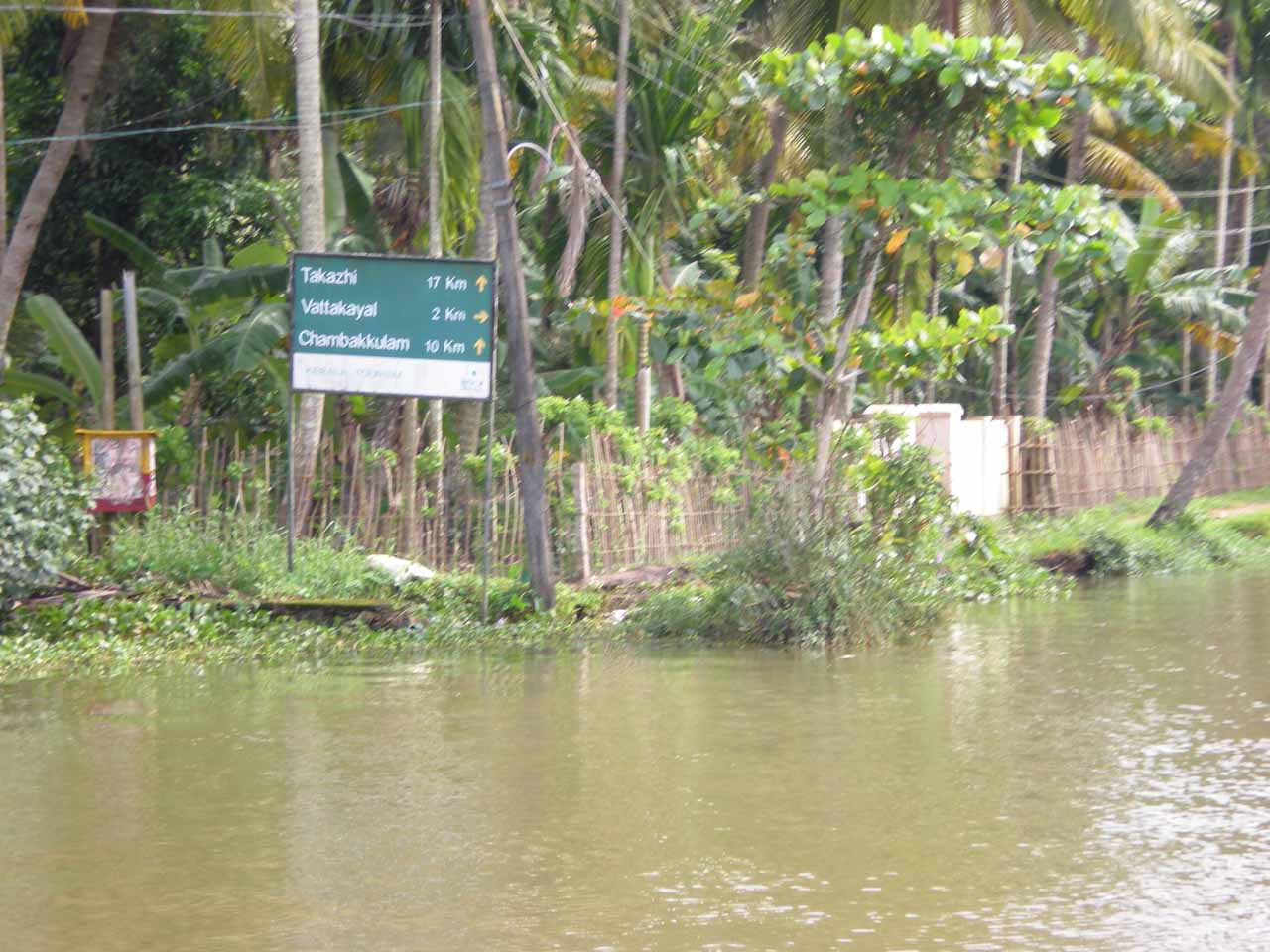 Road sign besides the canal