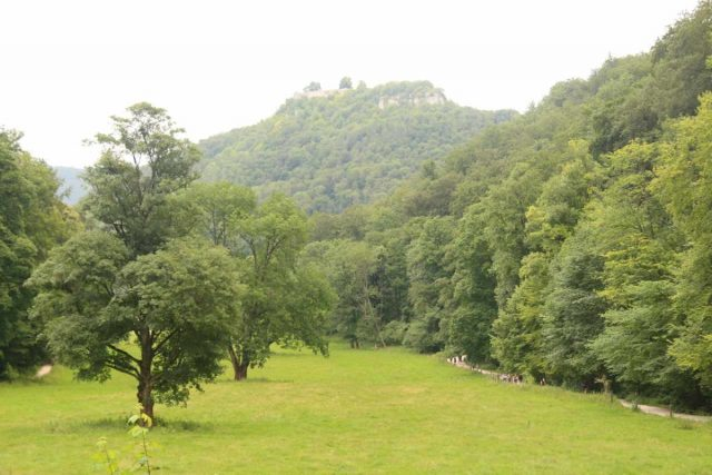 Bad_Urach_Waterfall_080_06232018 - The wide trail to the Urach Waterfall went alongside the Bruhlbach Creek as well as a wide open pasture. Note the castle ruin at the top of the hill in the distance suggesting that there are other activities in the Bad Urach area