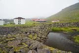 Baejarfoss_037_08172021 - Looking across this rock wall that might be acting as a sort of dam to reduce the outflow of the water in times of flood thereby minimizing damage further downstream in Ólafsvík