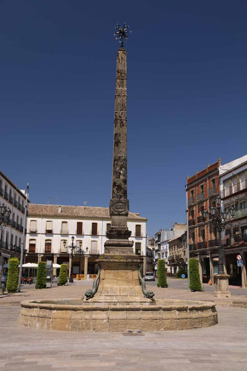 An obelisk-like statue or pillar at one end of the Paseo de la Constitucion in Baeza