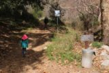 Bailey_Canyon_Falls_018_01212017 - Tahia and Julie going past the familiar sign at the trail junction by the bridge en route into Bailey Canyon