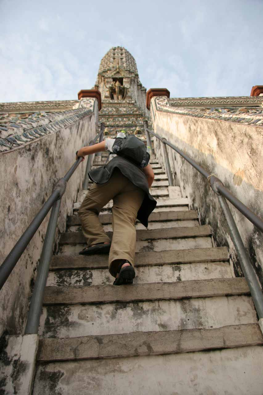Julie climbing up the steep steps of Wat Arun