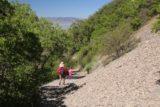 Battle_Creek_Falls_120_05282017 - Julie and Tahia descending alongside the talus slope of Battle Creek Trail with Utah Lake in the distance