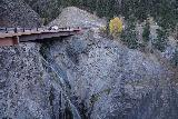 Bear_Creek_Falls_Ouray_018_10162020 - Context of the Million Dollar Highway (Hwy 550) crossing over Bear Creek with some hint of Fall foliage. Notice that drivers whizzing by over the bridge might miss the Bear Creek Falls like we did back in Summer of 2020 when we first passed by here