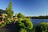 Bend_065_06262021 - Context of a riverside walkway alongside the Deschutes River at the Old Mill District in Bend