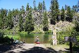 Benham_Falls_003_06272021 - Checking out some people floating or kayaking in a calm part of the Deschutes River by the East Trailhead for Benham Falls