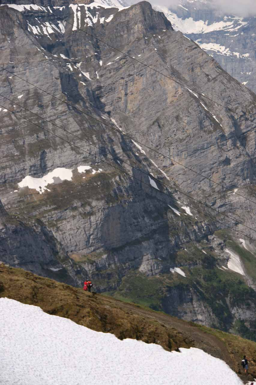 Hikers amidst the classic Swiss Alps scenery