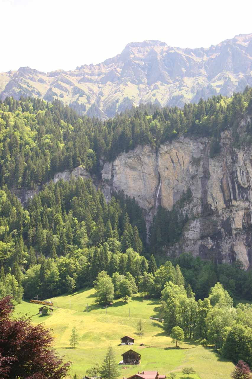 Looking across the valley from Lauterbrunnen towards some waterfall gushing out of a crack in the cliff