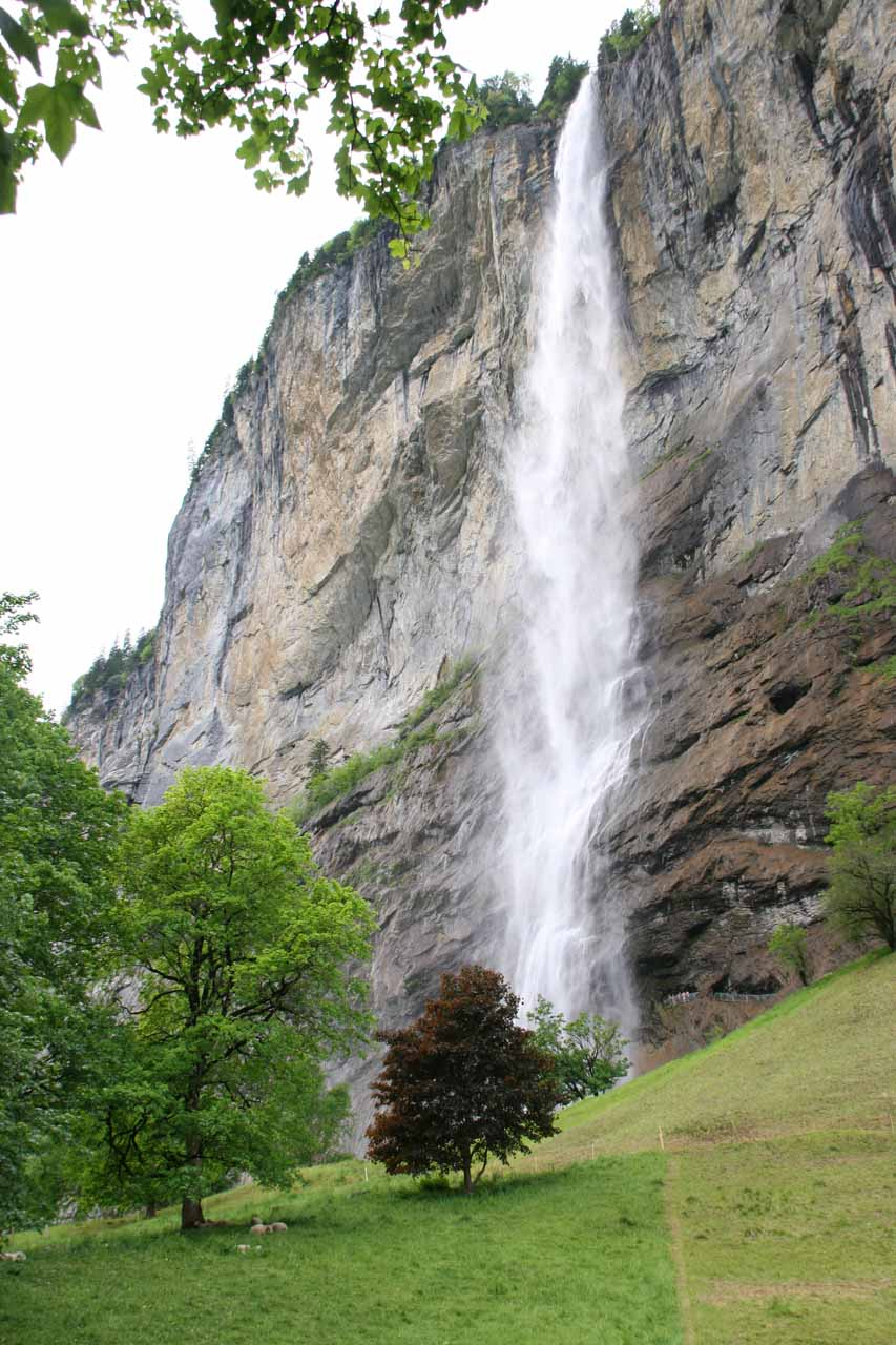 Staubbach Falls from top to bottom in its entirety seen as I was about to take the trail leading up to its backside from a spot carved into the cliff