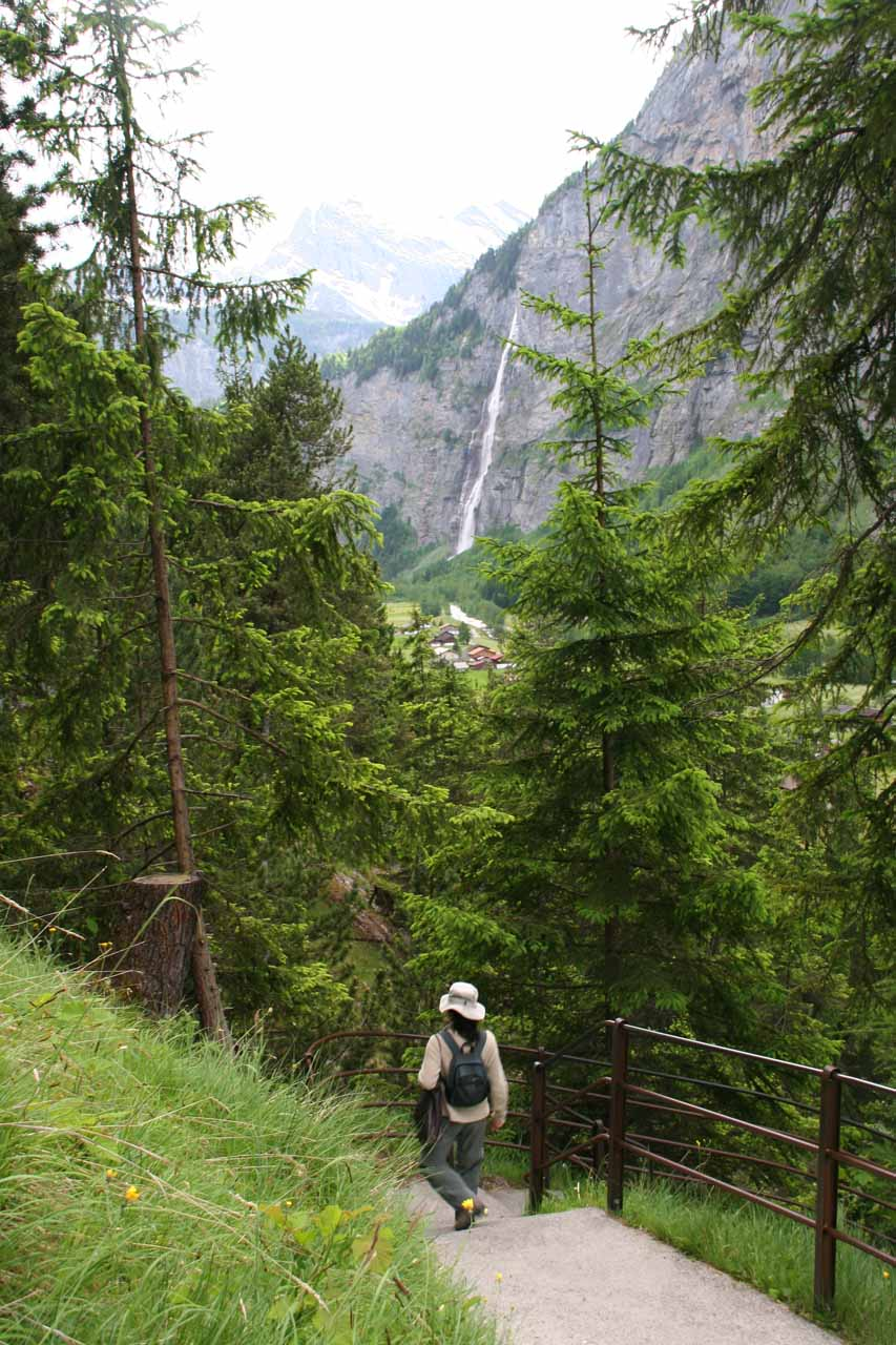 Julie descending along the path towards the lower chutes with Murrenbach Falls in the background