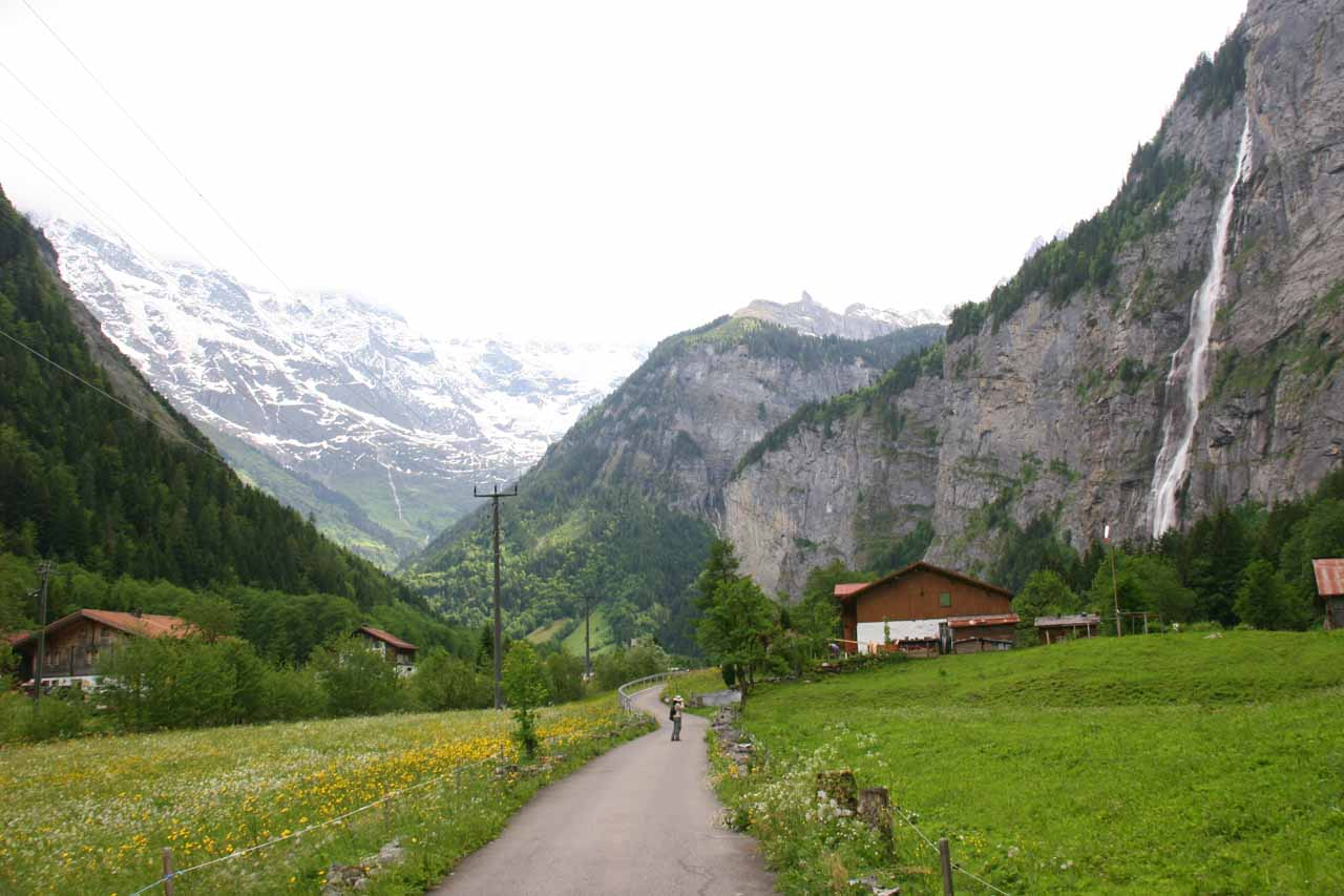 Walking deep within Lauterbrunnen Valley with the falls to the right