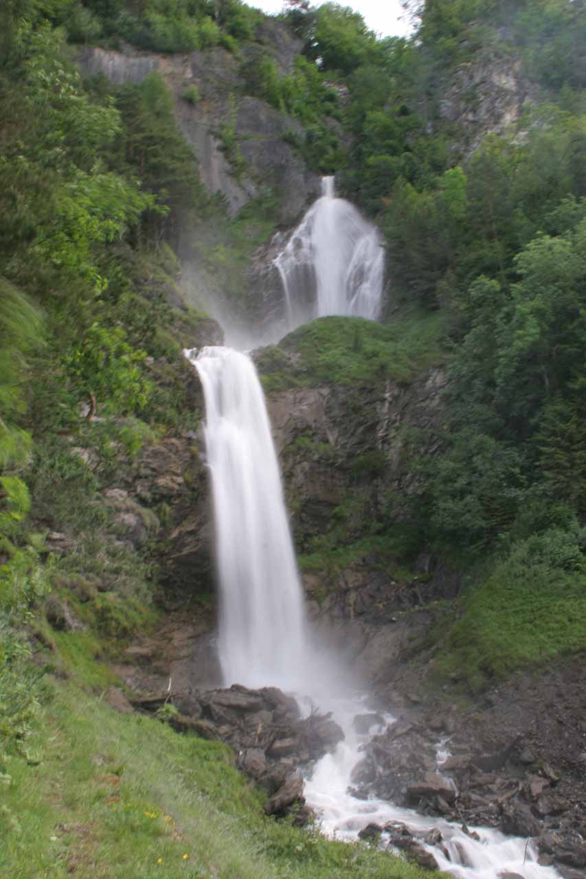 A waterfall behind some energy building in Meiringen