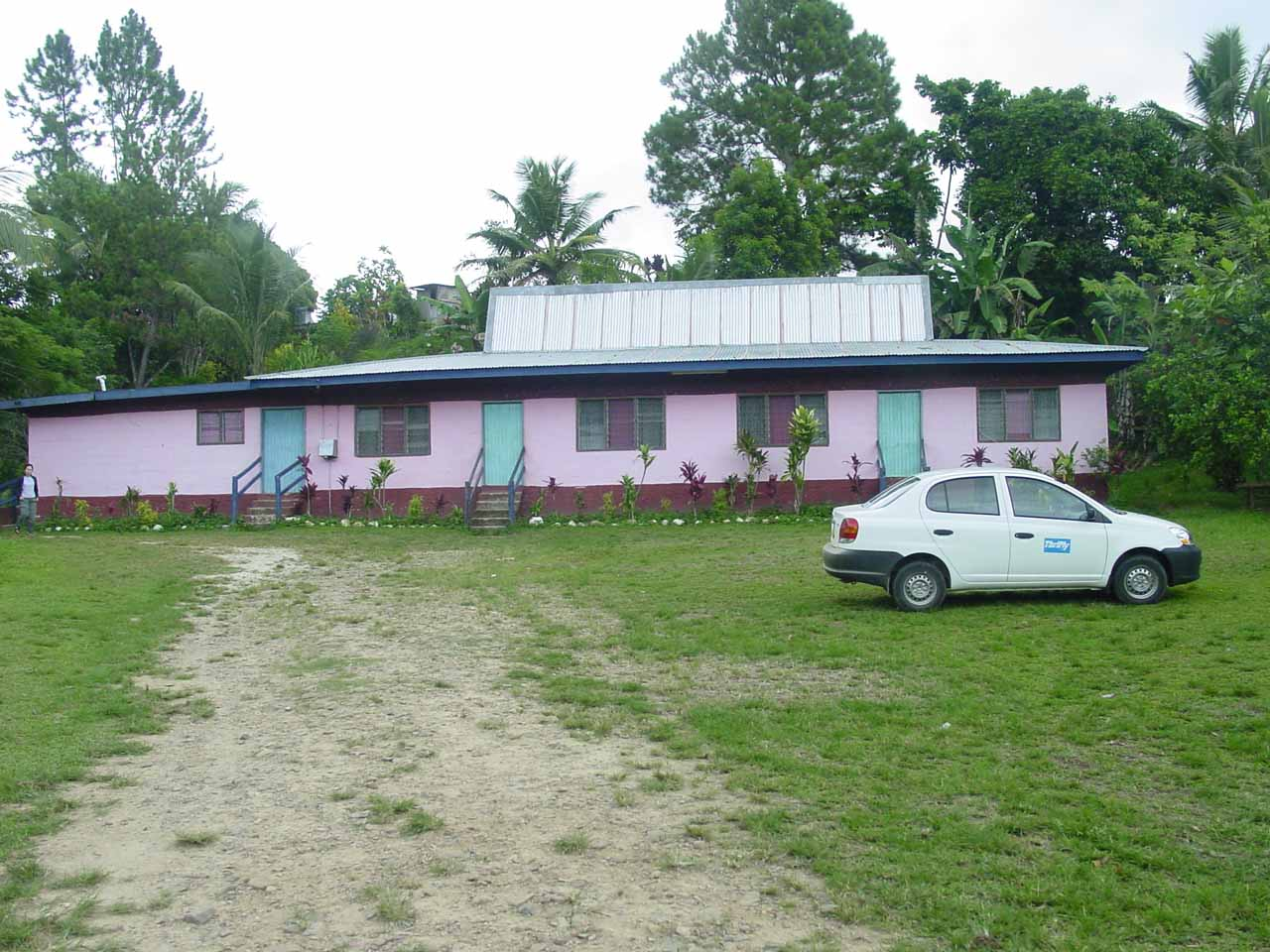The pink house and car park