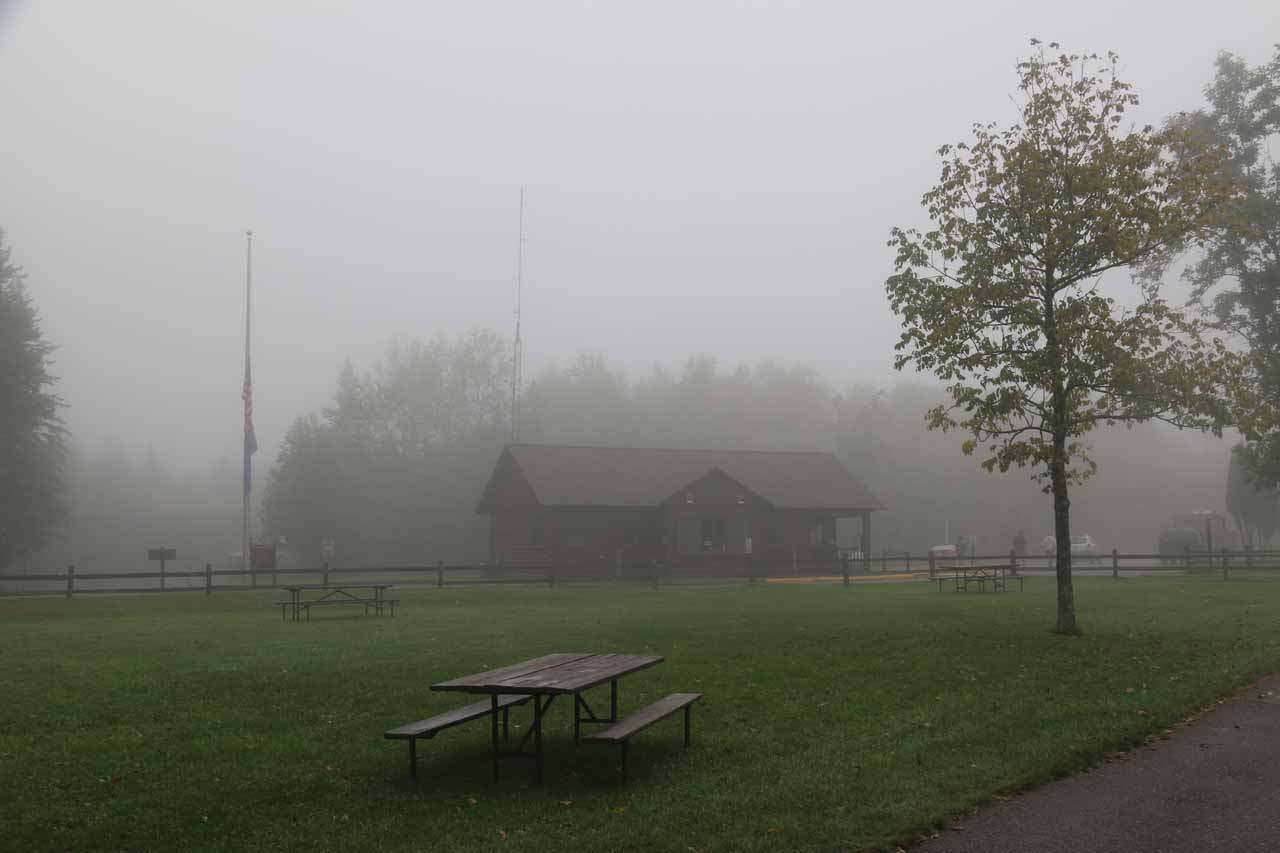 The main office and picnic area for Pattison State Park on a foggy morning